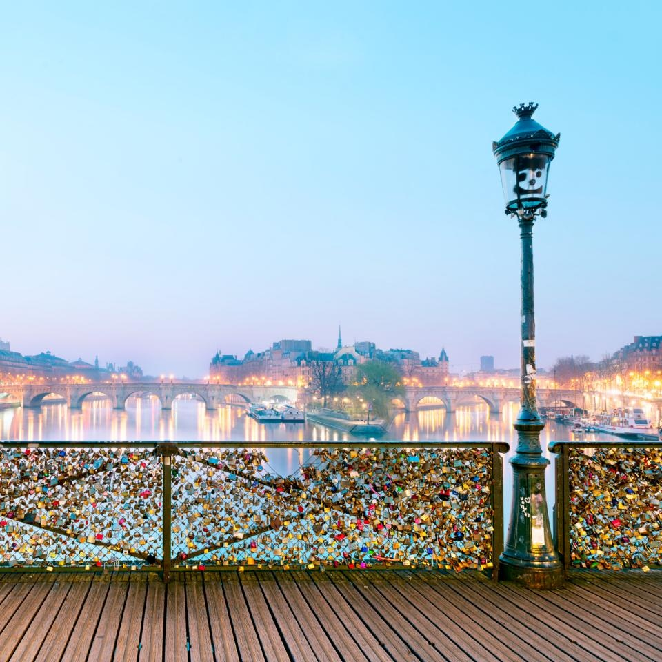 Photo of padlock bridge over the Seine River in Paris